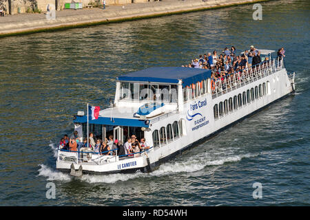Sightseeing Boats packed with visitors and tourists admiring the sights of Paris from The River Seine .Paris - Stock Photo