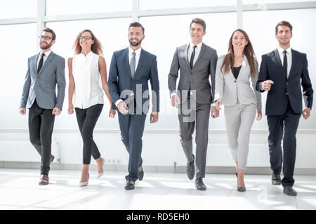 young business team confidently stepping forward - Stock Photo