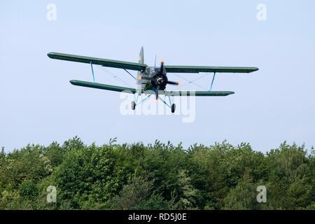 Antonov-2 biplane, celebration of the 100th anniversary of the airfield, in Lueneburg, Lower Saxony, Germany - Stock Photo