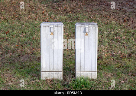Two little electricity box in the country - Stock Photo