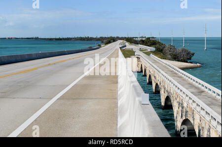 Overseas Highway: A modern bridge passes beside its older counterpart (now a fishing pier) as US Route 1 connects the Florida Keys. - Stock Photo