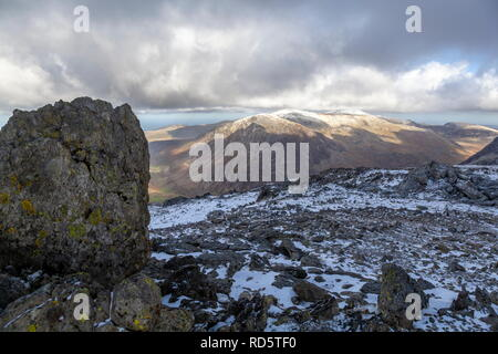 Viewed from the side of Gylder Fawr, a low lying cloud sits on the summits of the Carneddau, Snowdonia National Park - Stock Photo
