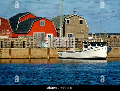 Lobster fishing boats tied up at a wharf in rural Prince Edward Island, Canada. - Stock Photo