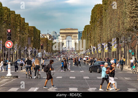 Traffic waits at a signal near Place de la Concorde on the Champs-Élysées with the Arc de Triomphe in the distance ,Paris ,France - Stock Photo