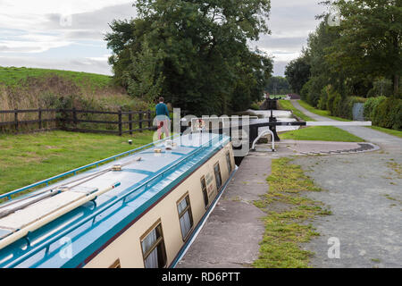 Narrowboat in Grindley Brook Lock No 15, Llangollen Canal, Shropshire, England,  MODEL RELEASED - Stock Photo