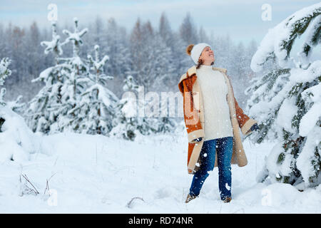 fa61b3c6f0 ... Young pregnant woman wearing warm clothes having fun on winter forest -  Stock Photo