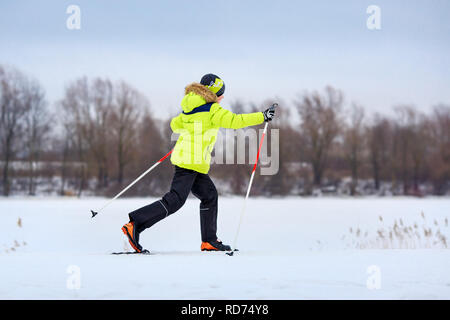 Cute little boy having fun during skiing on cross - Stock Photo