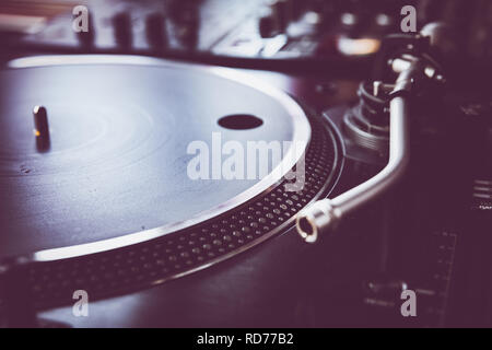 A close up of a DJ's (Disc Jockey's) turntables - Stock Photo