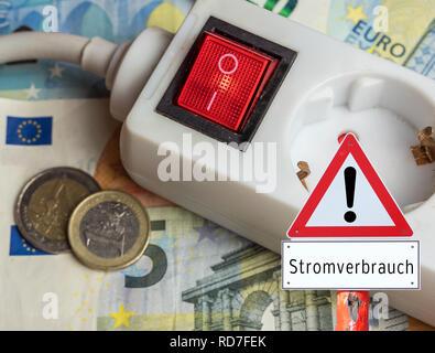 Warning sign power consumption - Stock Photo
