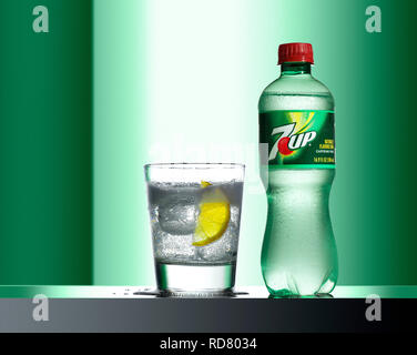 Bottle and glass of fizzy drink, studio shot - Stock Photo