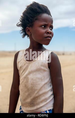 Portrait of a beautiful young Damara girl - Damaraland, Namibia, Africa - Stock Photo