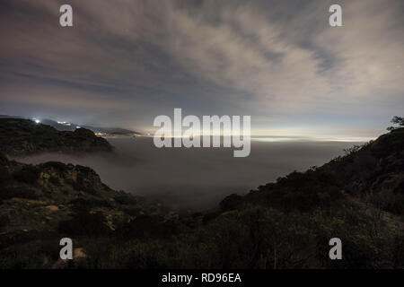 Dawn view towards foggy Porter Ranch in the west San Fernando Valley area of Los Angeles in Southern California. - Stock Photo