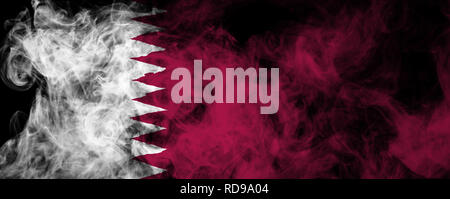 National flag of Qatar from thick colored smoke on a black isolated background - Stock Photo