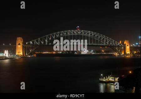 Sydney Harbour Bridge late at night after many of the lights are turned off, Sydney, Australia - Stock Photo
