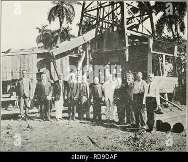 . The Cuba review. Cuba -- Periodicals. 30 THE CUBA REVIEW. Board of Directors of the Union Oil Co. Mine at Bacuranao. tiiue. The Cuban Petroleum Co. has a tank of about 2,000 bbls. capacity, where the petroleum is stored until it is sent to tbe refinery, which is located at Belot in Havana. This refinery is operated by the West India Oil Refining Co. The petroleum pumped by the Union Oil Co. is said to contain 22% gasoline, some para- fin and other valuable substances. The Union Oil Co. operates four wells and is pumping approximately 35 bbls. daily from well No. 4 and 15 bbls. daily from wel - Stock Photo