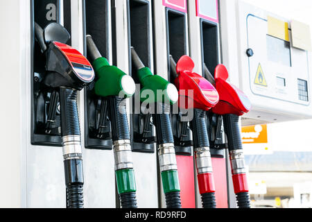 Gasoline and diesel distributor at the gas station. Gas pump nozzles. Petrol filling gun close-up at the gas station. Colorful Petrol pump filling noz - Stock Photo