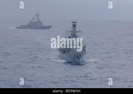 190115-N-WK982-1420 SOUTH CHINA SEA (Jan. 15, 2018) The Arleigh Burke-class guided-missile destroyer USS McCampbell (DDG 85) and the Royal Navy Type 23 'Duke' Class guided-missile frigate HMS Argyll (F231) maneuver during a divisional tactics exercise. McCampbell is forward-deployed to the U.S. 7th Fleet area of operations in support of security and stability in the Indo-Pacific region. (U.S. Navy photo by Mass Communication Specialist 2nd Class John Harris/Released) - Stock Photo
