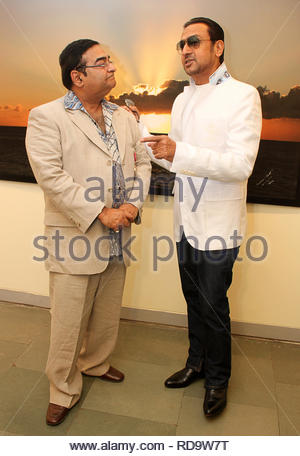 Homeopath Dr Mukesh Batra (L) with Bollywood actor Gulshan Grover at the inauguration of his 8th annual charity photgraphy exhibition in Mumbai, India on September 13, 2012. (SOLARIS IMAGES) - Stock Photo