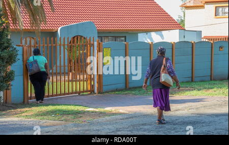 Johannesburg, South Africa - unidentified black women working as domestic workers on their way to work in the city - Stock Photo