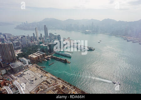 Aerial view of harbour with urban skyscrapers and sea. Hong Kong, China. - Stock Photo
