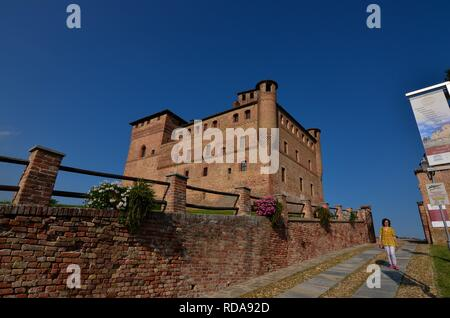 Grinzane Cavour, Piedmont, Italy. July 2018. The majestic castle made of red bricks. Highly visible, it is a reference point for this small town. It i - Stock Photo