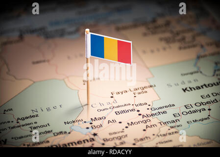 Chad marked with a flag on the map - Stock Photo