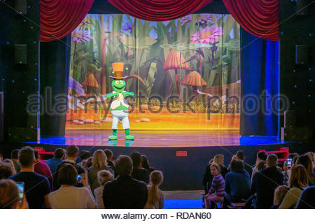 Kownaty, Poland - January 6, 2019: Person dressed as cricked performing on a stage in front of a audience in the Majaland attraction park. - Stock Photo