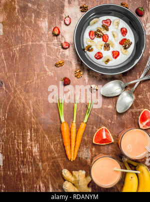 Semolina porridge with berries and fruit smoothies. On rustic background. - Stock Photo