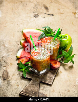 Fruit smoothie with watermelon. On wooden background. - Stock Photo