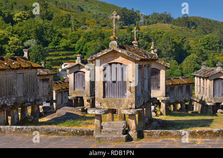 Traditional granite stone corn storages in northern Portugal - Stock Photo