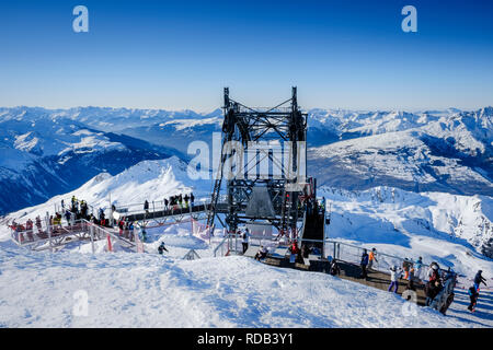The lift station at Aiguille Rouge, with people enjoying the panoramic view of the Alps. - Stock Photo