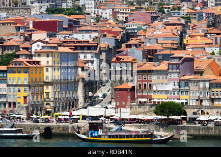 Old ship and houses in the hills of downtown Porto Portugal. - Stock Photo