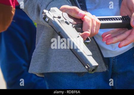 The gun in the man's hand - Stock Photo