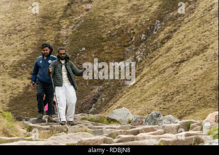 Walkers on the ben nevis path make there way up and down - Stock Photo