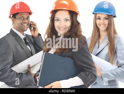 Two women and a man architect team. Isolated on a white background. - Stock Photo
