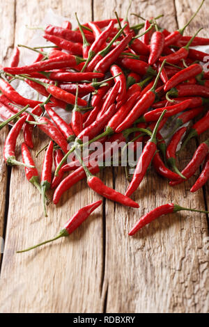 Red hot chili pepper piri piri close up on wooden background. vertical - Stock Photo