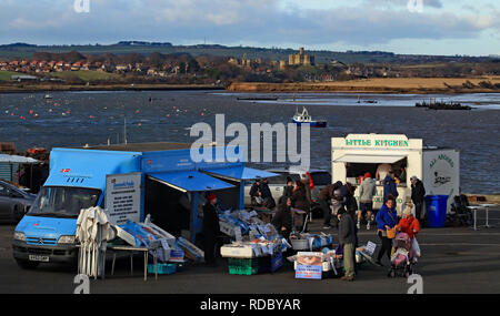 Cw 6548 Amble Sunday market and Warkworth Castle  The Sunday market held on the harbour side in the coastal town of Amble. - Stock Photo