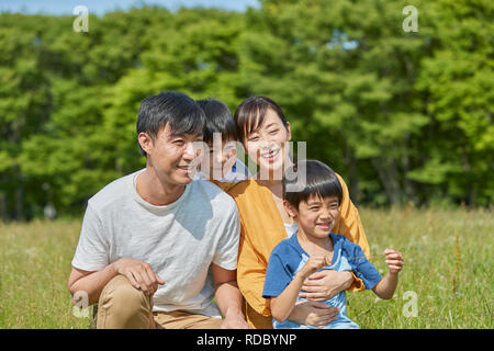 Japanese family in a city park - Stock Photo