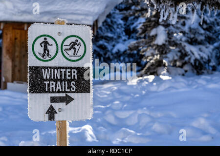 Winter trails sign for snowshoeing and cross country skiing - Stock Photo