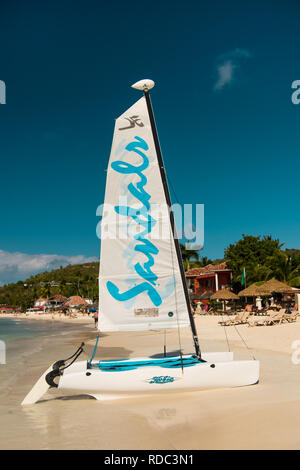 St.johns, Antigua - March 05, 2017: yacht on water and sandy sea coast on beach sunny. sandals yacht for tourists on summer beach in dockyard of st johns, antigua. travel and vacation - Stock Photo