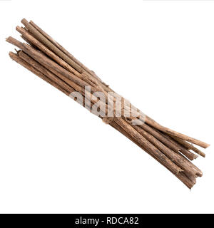 Bundle of sticks, twigs, isolated over white. Tied with string. - Stock Photo