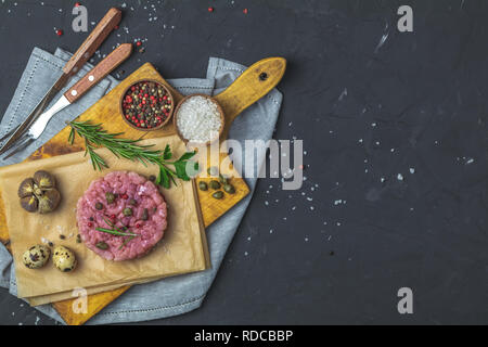 Healthy food, cooking concept. Homemade raw organic Ground beef Burger steak patties cutlet with vegetables. Copy space background, top view flat lay. - Stock Photo