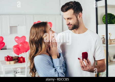 selective focus of man doing proposal at valentines day to girlfriend - Stock Photo