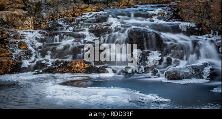 Small waterfall in winter on the River Coe in Glencoe in the Scottish Highlands - Stock Photo