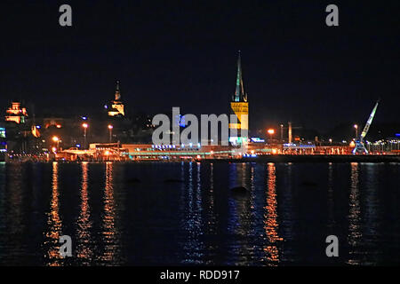 View of the old town of Tallinn and Saint Olaf church at the night, Estonia - Stock Photo