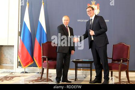 Belgrade, Serbia. 17th January, 2019. Russian President Vladimir Putin, left, shakes hands with Serbian President Aleksandar Vucic, right, prior to the start of a bilateral meeting January 17, 2019 in Belgrade, Serbia. Credit: Planetpix/Alamy Live News - Stock Photo