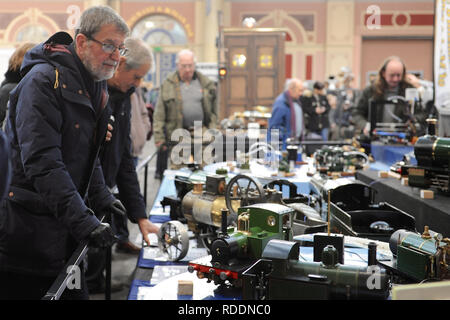London, UK. 18th Jan 2019. Visitors looking at scale model engineering at the London Model Engineering Exhibition which opened today at Alexandra Palace, London.  The London Model Engineering Exhibition is now in its 23rd year, and attracts around 14,000 visitors.  The show offers a showcase to the full spectrum of modelling from traditional model engineering, steam locomotives and traction engines through to the more modern gadget and boys toys including trucks, boats, aeroplanes and helicopters. Credit: Michael Preston/Alamy Live News - Stock Photo