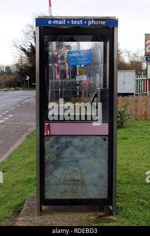 British Telecom phone booth in train station Brighton. England, UK - Stock Photo
