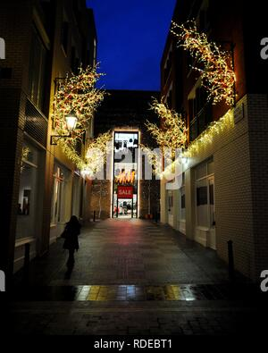 Christmas decorations leading to the H&M store on Mercer Walk, London, UK. - Stock Photo