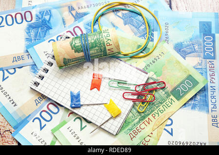 Russian money, notebook for records and paper clips. Business still-life - Stock Photo